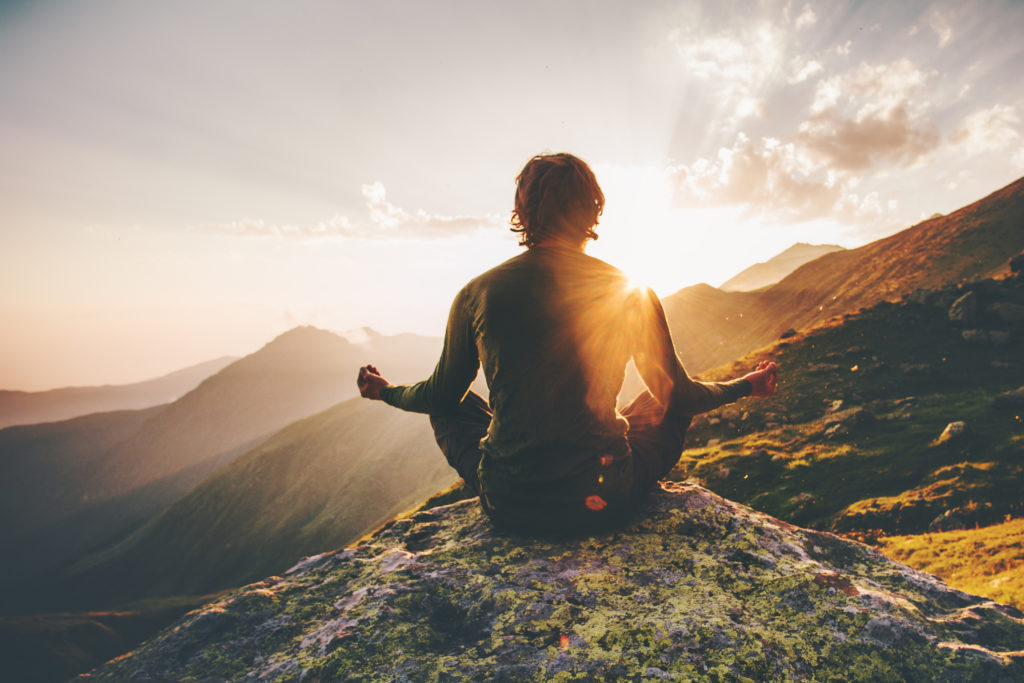 Meditation and relaxing on top of a mountain